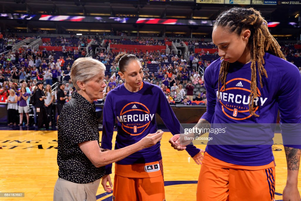 Carol Callan of USA Women's Basketball Team presents rings to Diana Taurasi and Brittney Griner for their gold medal win at the 2016 Rio Olympics on May 14, 2017 at Talking Stick Resort Arena in Phoenix, Arizona.