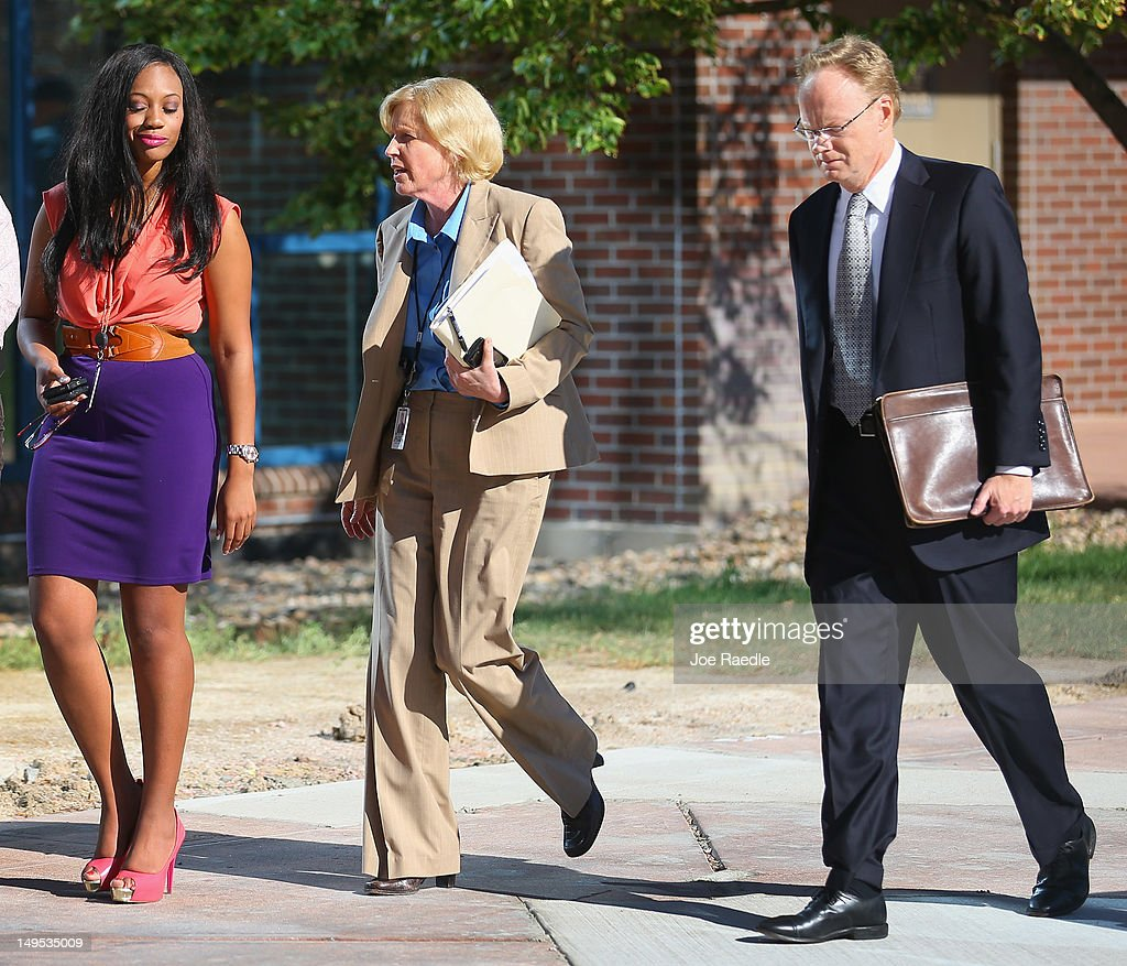 Carol Chambers, 18th Judicial District Attorney lead prosecutor (C), is seen as she arrives at the Arapahoe County Courthouse for suspect James Holmes' arraignment hearing July 30, 2012 in Centennial, Colorado. James Holmes, 24, who is accused of killing 12 people and injuring 58 in a shooting spree July 20, during a screening of 'The Dark Knight Rises.' in Aurora, Colorado.