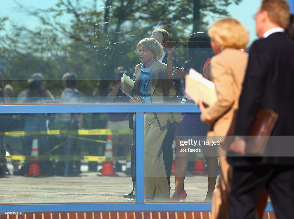 Carol Chambers, 18th Judicial District Attorney lead prosecutor, is seen reflected in a mirrored window as she arrives at the Arapahoe County Courthouse for suspect James Holmes' arraignment hearing July 30, 2012 in Centennial, Colorado. James Holmes, 24, who is accused of killing 12 people and injuring 58 in a shooting spree July 20, during a screening of 'The Dark Knight Rises.' in Aurora, Colorado.