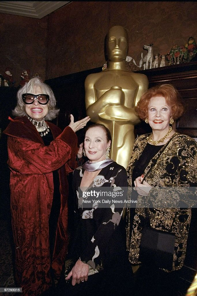 Carol Channing, Rita Gam and Arlene Dahl (l. to r.) with the eight-foot statue of Oscar at the Academy Awards party at '21.',