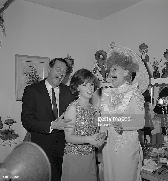 Carol Channing starring in the hit musical Hello Dolly is delighted as she entertains movie stars Gina Lollobrigid and Rock Hudson in her dressing...