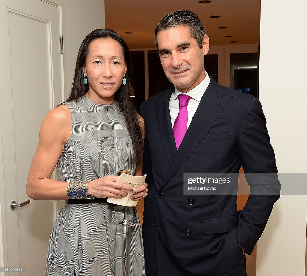 Carol Cheng-Mayer (L) and Vacheron Constantin North America President, Hugues de Pins, attend the Vacheron Constantin High Jewelry Collection Dinner at a private residence on October 10, 2013 in Los Angeles, California.