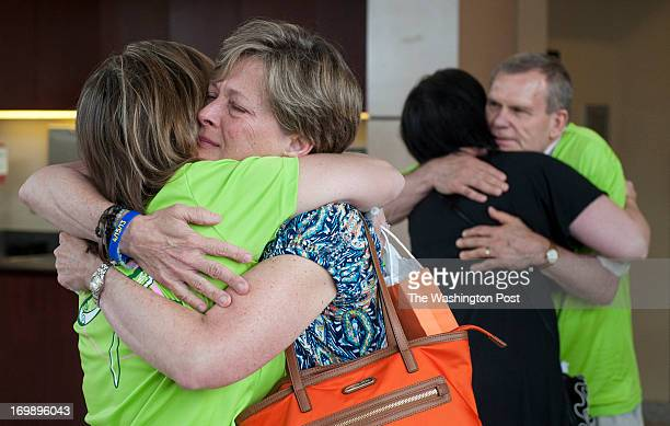 Carol Downing sheds a tear as she gets a hug from Stacy Massengill Monday June 3 2013 in Glen Burnie MD She and her daughter Erika Brannock arrivied...