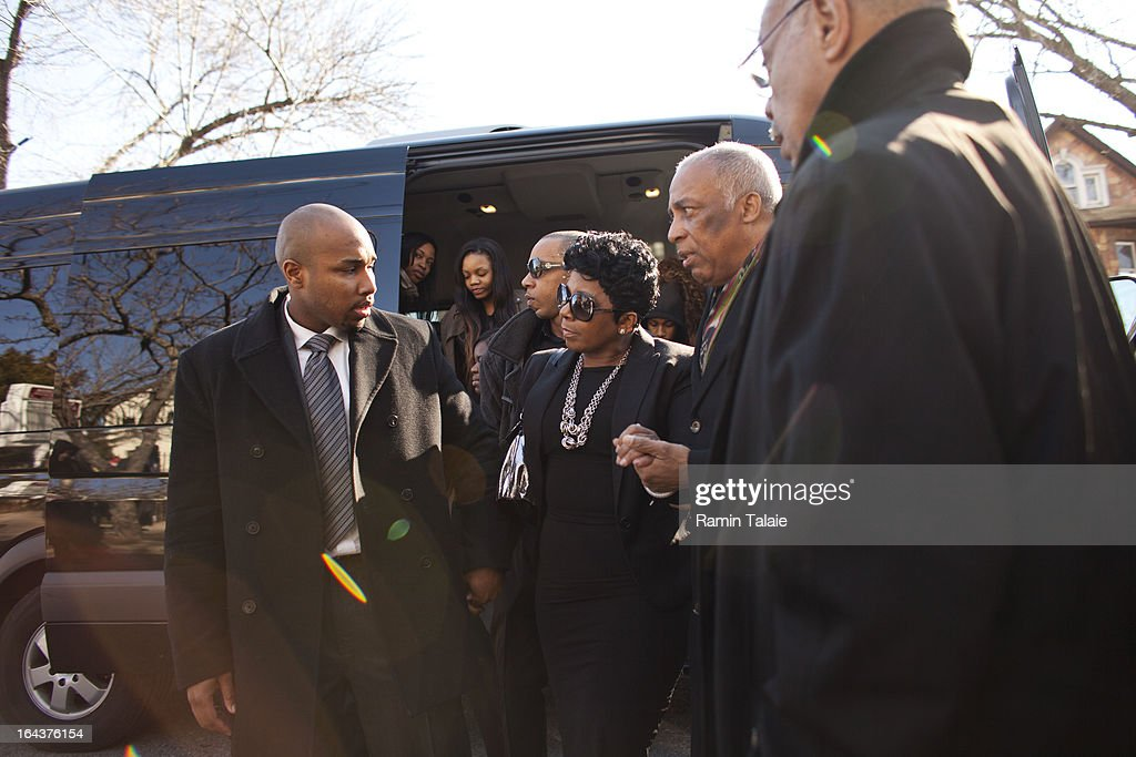 Carol Gray (C), mother of Kimani Gray, 16, is escorted by City Councilman Charles Barron (2R) and family members as she arrives for her son's funeral at St. Catherine of Genoa Church on March 23, 2013 in the Brooklyn borough of New York City. Kimani Gray was shot and killed by New York police officers for allegedly pointing a gun at them.