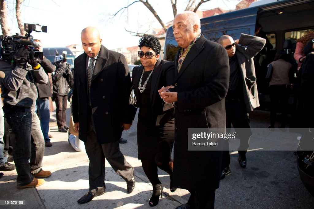 Carol Gray (C), mother of Kimani Gray, 16, is escorted by City Councilman Charles Barron (R) and family members as she arrives for her son's funeral at St. Catherine of Genoa Church on March 23, 2013 in the Brooklyn borough of New York City. Kimani Gray was shot and killed by New York police officers for allegedly pointing a gun at them.