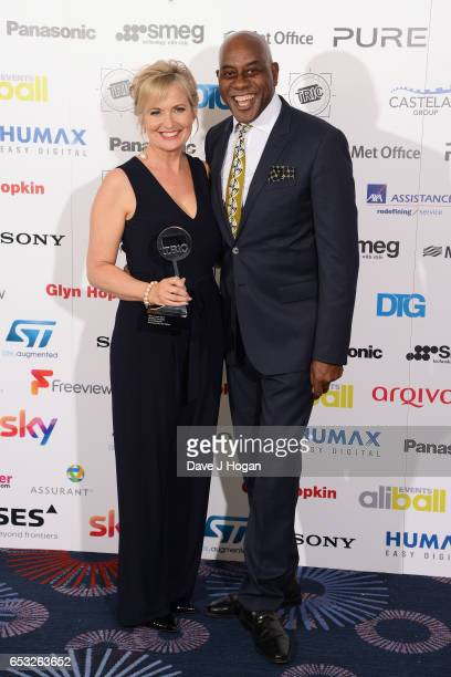 Carol Kirkwood and Ainsley Harriott pose in the winners room with the award for Weather Presenter at the TRIC Awards 2017 at The Grosvenor House...