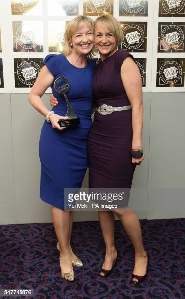 Carol Kirkwood with her TV Weather Presenter award presented to her by Louise Minchin during the Television and Radio Industries Club Awards at...
