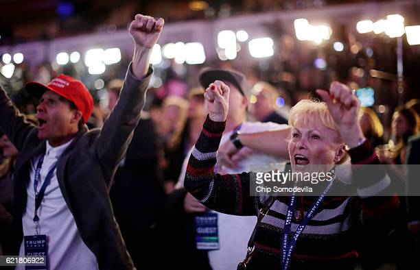 Carol Minor along with other supporters of Republican presidential nominee Donald Trump cheer during the election night event at the New York Hilton...