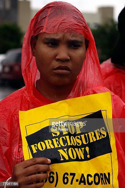 Carol Mondesir participates in a protest in front of Ocwen Financial a subprime loan servicer September 26 2007 in West Palm Beach Florida The...