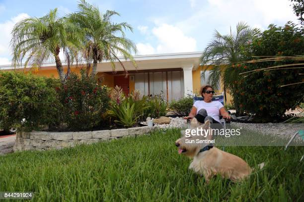 Carol Schumacher who plans to ride out the storm with her husband Bob and dog Casey in their LauderdaleByTheSea home sits in a lawn chair in her...