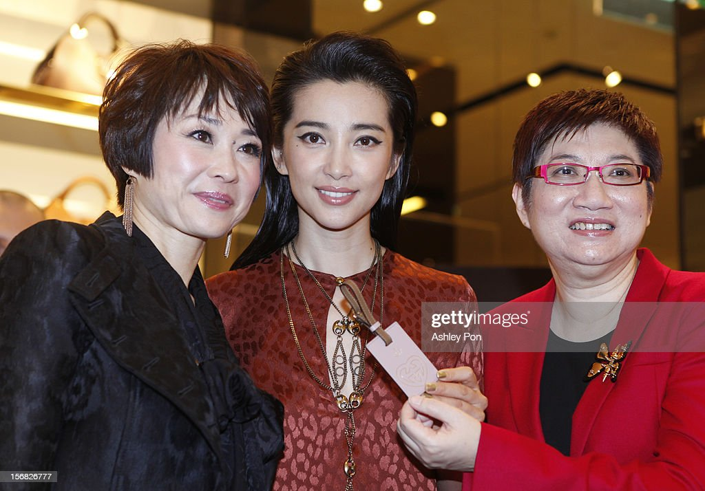 Carol Shen and <a gi-track='captionPersonalityLinkClicked' href=/galleries/search?phrase=Li+Bingbing&family=editorial&specificpeople=697017 ng-click='$event.stopPropagation()'>Li Bingbing</a> and Magdalen Ho photographed at the Gucci Flagship store opening at Taipei101 on November 22, 2012 in Taipei, Taiwan.