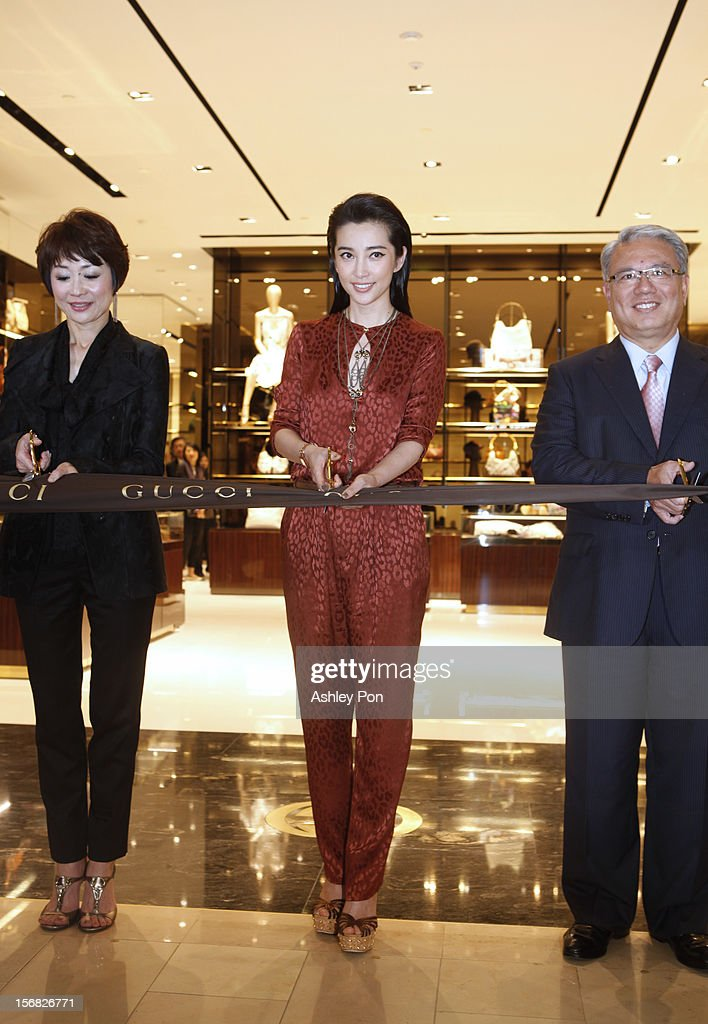 Carol Shen and Li Bingbing and Wei Ying-chiao attend the ribbon cutting at the Gucci Flagship store opening at Taipei101 on November 22, 2012 in Taipei, Taiwan.