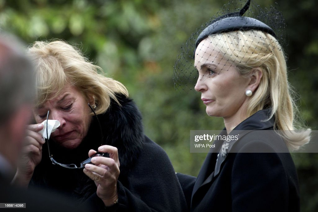 <a gi-track='captionPersonalityLinkClicked' href=/galleries/search?phrase=Carol+Thatcher&family=editorial&specificpeople=225096 ng-click='$event.stopPropagation()'>Carol Thatcher</a> is consoled by sister-in-law Sarah as they arrive at Mortlake Crematorium following the funeral of former British Prime Minister Margaret Thatcher, on April 17, 2013 in London, England. Dignitaries from around the world today join Queen Elizabeth II and Prince Philip, Duke of Edinburgh as the United Kingdom pays tribute to former Prime Minister Baroness Thatcher during a Ceremonial funeral with military honours at St Paul's Cathedral. Lady Thatcher, who died last week, was the first British female Prime Minister and served from 1979 to 1990.
