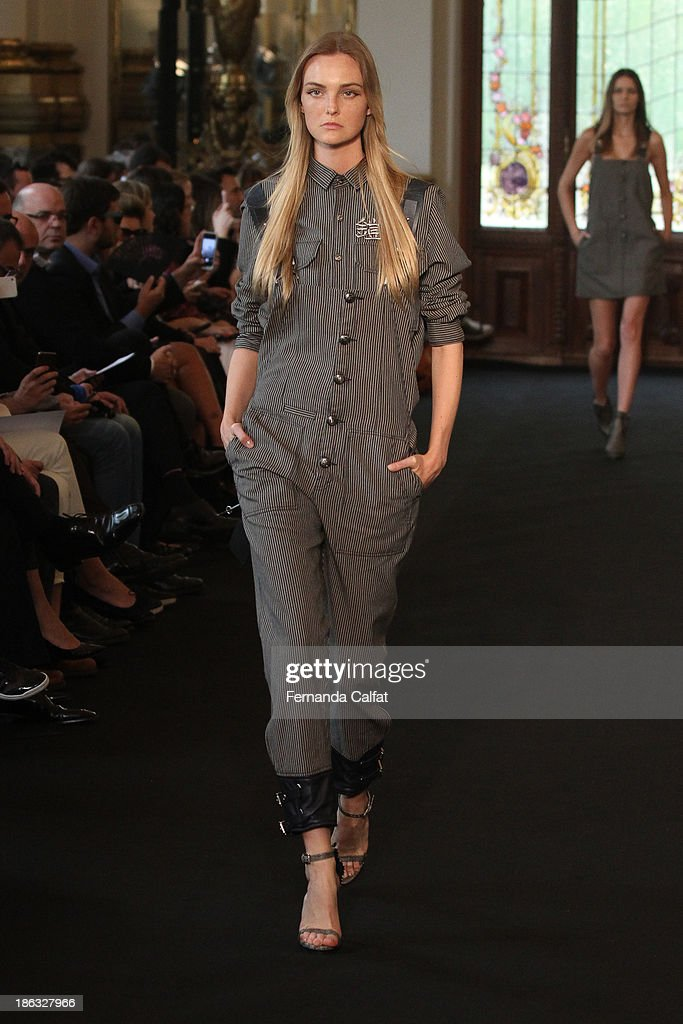 Carol Trentine walks the runway during Ellus show at Sao Paulo Fashion Week Winter 2014 on October 30, 2013 in Sao Paulo, Brazil.