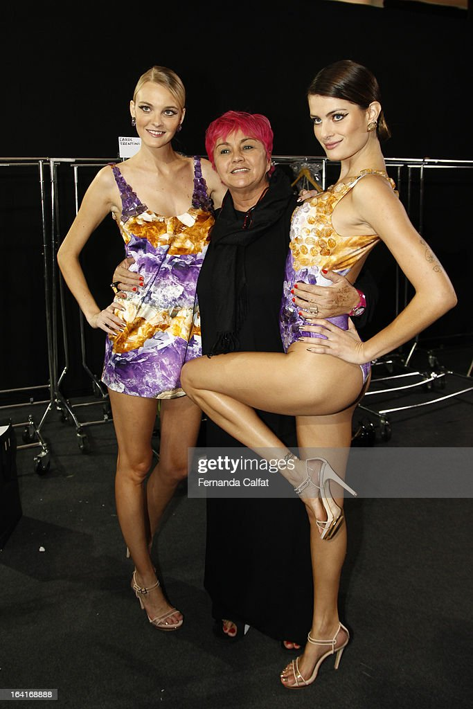 Carol Trentini and <a gi-track='captionPersonalityLinkClicked' href=/galleries/search?phrase=Isabeli+Fontana&family=editorial&specificpeople=220508 ng-click='$event.stopPropagation()'>Isabeli Fontana</a> pose backstage at the Agua de Coco show during Sao Paulo Fashion Week Summer 2013/2014 on March 20, 2013 in Sao Paulo, Brazil.