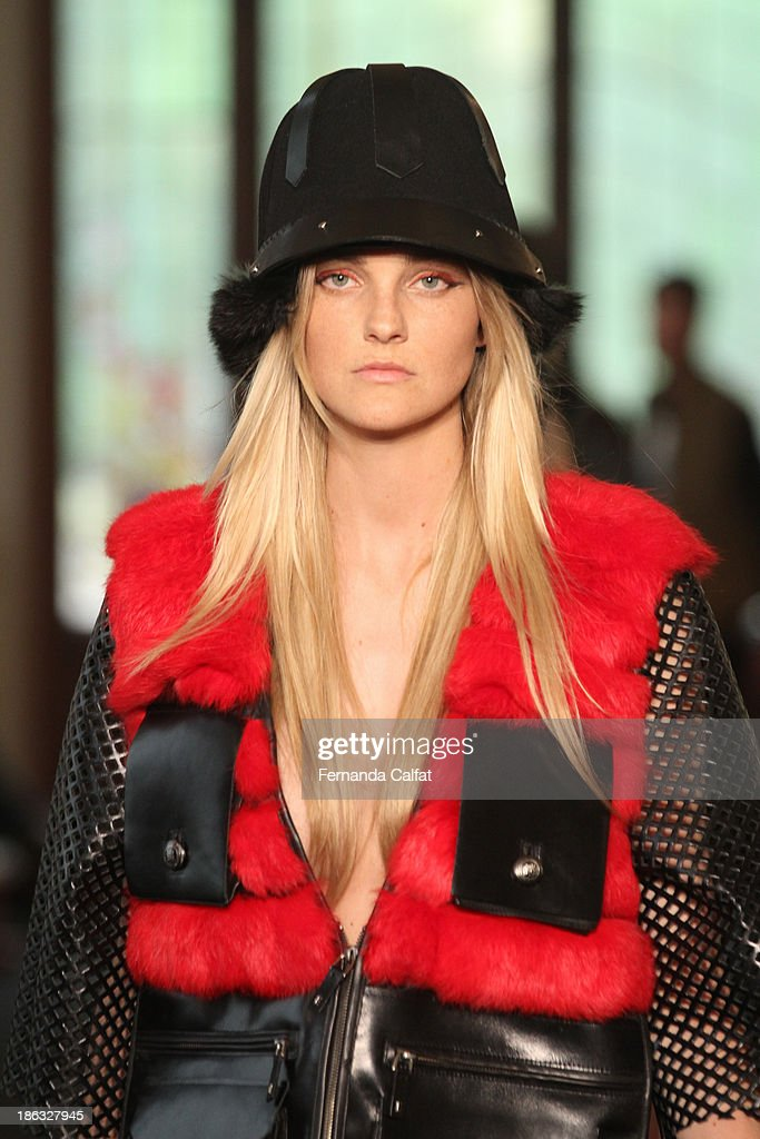 <a gi-track='captionPersonalityLinkClicked' href=/galleries/search?phrase=Carol+Trentini&family=editorial&specificpeople=235720 ng-click='$event.stopPropagation()'>Carol Trentini</a> walks the runway during Ellus show at Sao Paulo Fashion Week Winter 2014 on October 30, 2013 in Sao Paulo, Brazil.