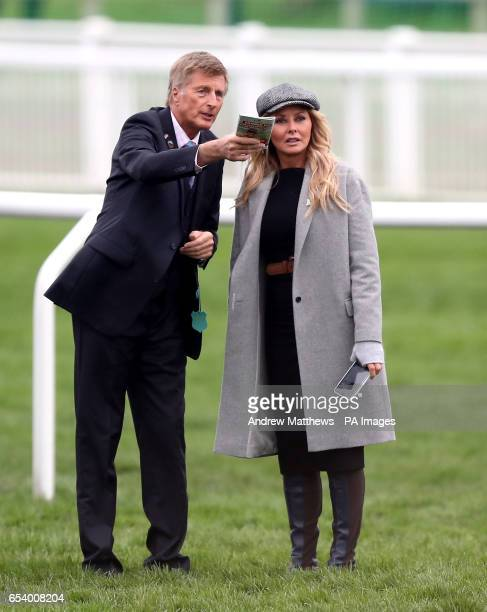Carol Vorderman and trainer Michael Dickinson on the course during St Patrick's Thursday of the 2017 Cheltenham Festival at Cheltenham Racecourse