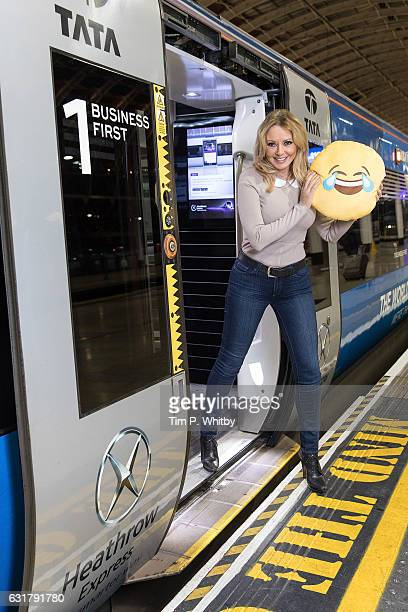 Carol Vorderman poses for a photo with a happy emoji to help cheer passengers on 'Blue Monday' and to highlight the Heathrow Express Service from...