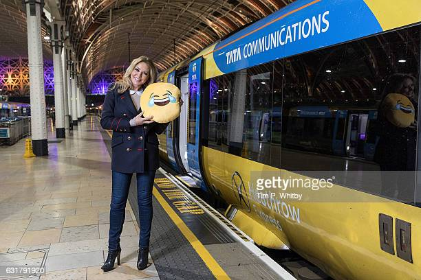 Carol Vorderman poses for a photo with a happy emoji to help cheer passengers on 'Blue Monday' to highlight the Heathrow Express Service from...