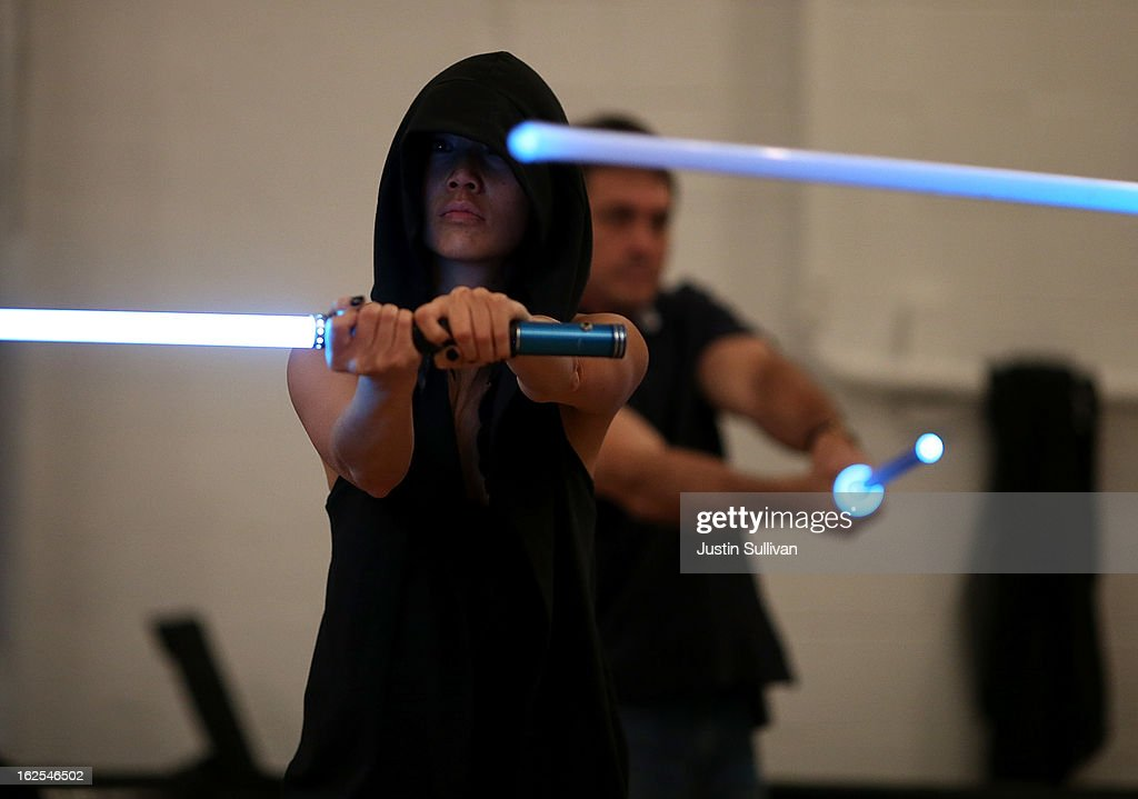 Carol Wong performs combat moves using a lightsaber during a Golden Gate Knights class in saber choreography on February 24, 2013 in San Francisco, California. Star Wars fans Alain Bloch and Matthew Carauddo founded the Golden Gate Knights in 2011 to teach classes on how to safely wield a lightsaber and perform choreographed moves. The three hour class costs ten dollars and all equipment is provided.