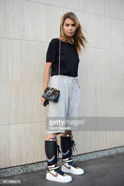 Carola Bernard is seen wearing nike shoes and a Paula Cademartori clutch after Prada show on June 22 2014 in Milan Italy