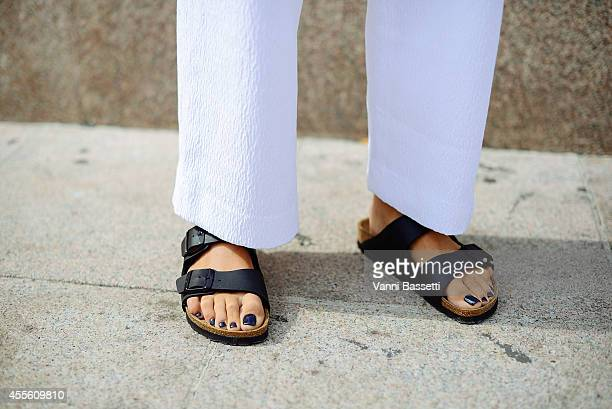 Carola Bernard poses wearing a Come for Breakfast dress and Birkenstock shoes on September 17 2014 in Milan Italy
