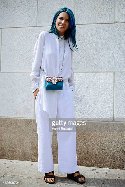 Carola Bernard poses wearing a Come for Breakfast dress Birkenstock shoes and a Paula Cademartori bag on September 17 2014 in Milan Italy