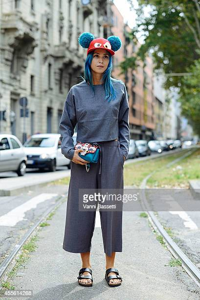 Carola Bernard poses wearing a Monki top and pants Piers Atkinson hat Paula Cademartori bag and Birkenstock shoes on September 17 2014 in Milan Italy
