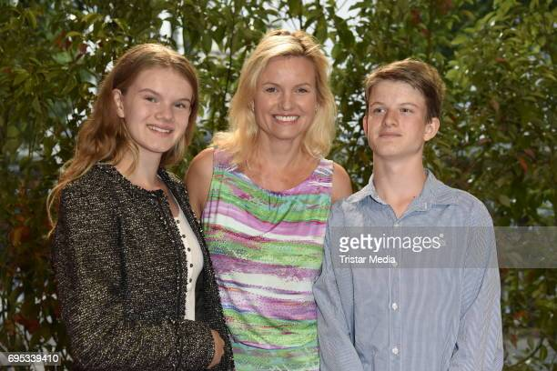 Carola Ferstl with her daughter Lilly Ferstl and son Georg Ferstl attend the Cocktail prolonge to the SemiFinal Round Of Judging Of The International...