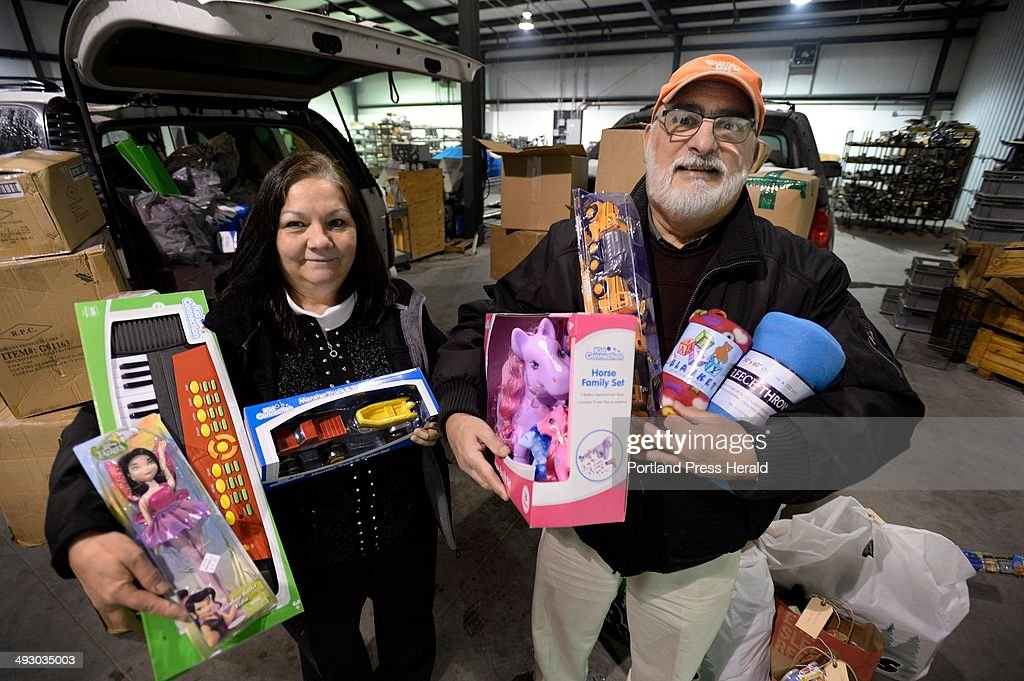 Carole and Paul Deschambault of the BiddefordSaco Rotary show off some of the gifts the rotary club collected for the children of LacMegantic where a...