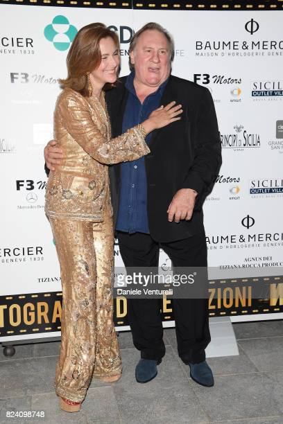 Carole Bouquet and Gerard Depardieu attend Nations Award gala dinner on July 28 2017 in Taormina Italy