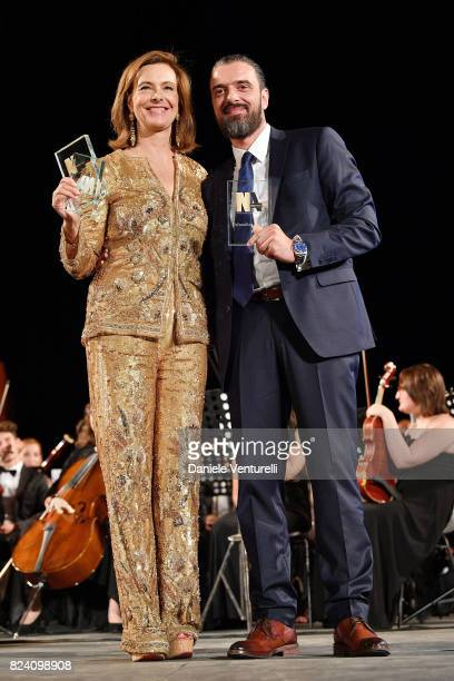Carole Bouquet and Sotiris Tsafulias attend Nations Award presentation on July 28 2017 in Taormina Italy