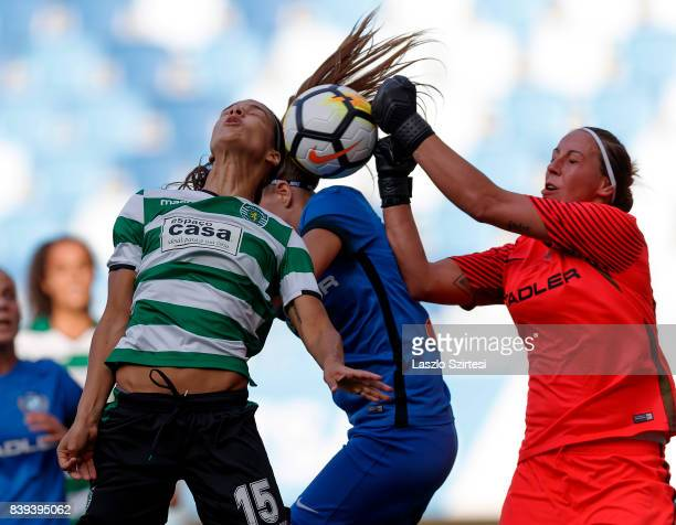 Carole Costa of Sporting CP battles for the ball in the air with Reka Szocs of MTK Hungaria FC and Lilla Turanyi of MTK Hungaria FC during the UEFA...