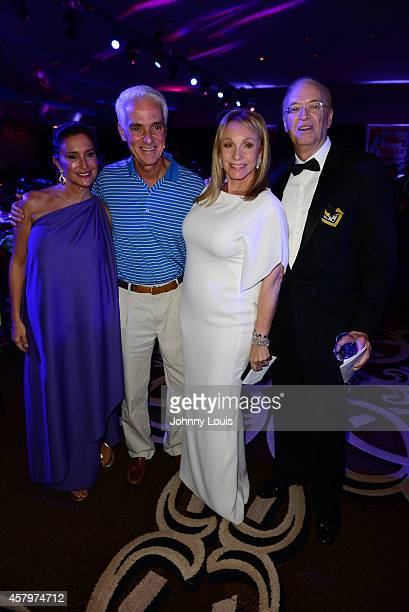 Carole Crist Charlie Crist Lea Black and Roy Black attend The Blacks Annual Gala at Fontainebleau Miami Beach on October 25 2014 in Miami Beach...