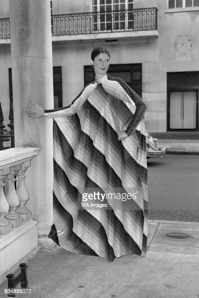 Carole is wearing a black and white checked kaftanstyle gown in 100 per cent dicel The gown is called 'Chequers' and is from the Jean Allen...