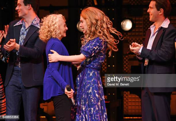 Carole King and Cassidy Janson pose onstage with cast members as Carole King surprises the West End cast of 'Beautiful The Carole King Musical' at...
