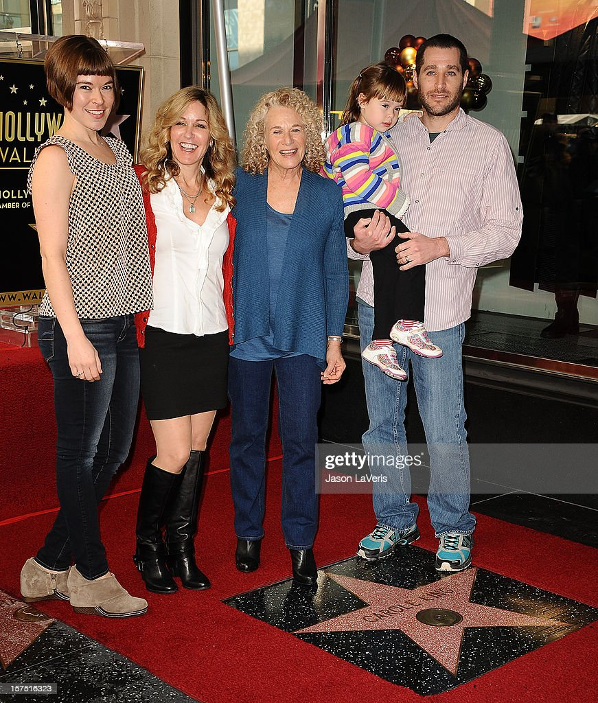 Carole King (C) and family attend King's induction into the Hollywood Walk of Fame December 3, 2012 in Hollywood, California.