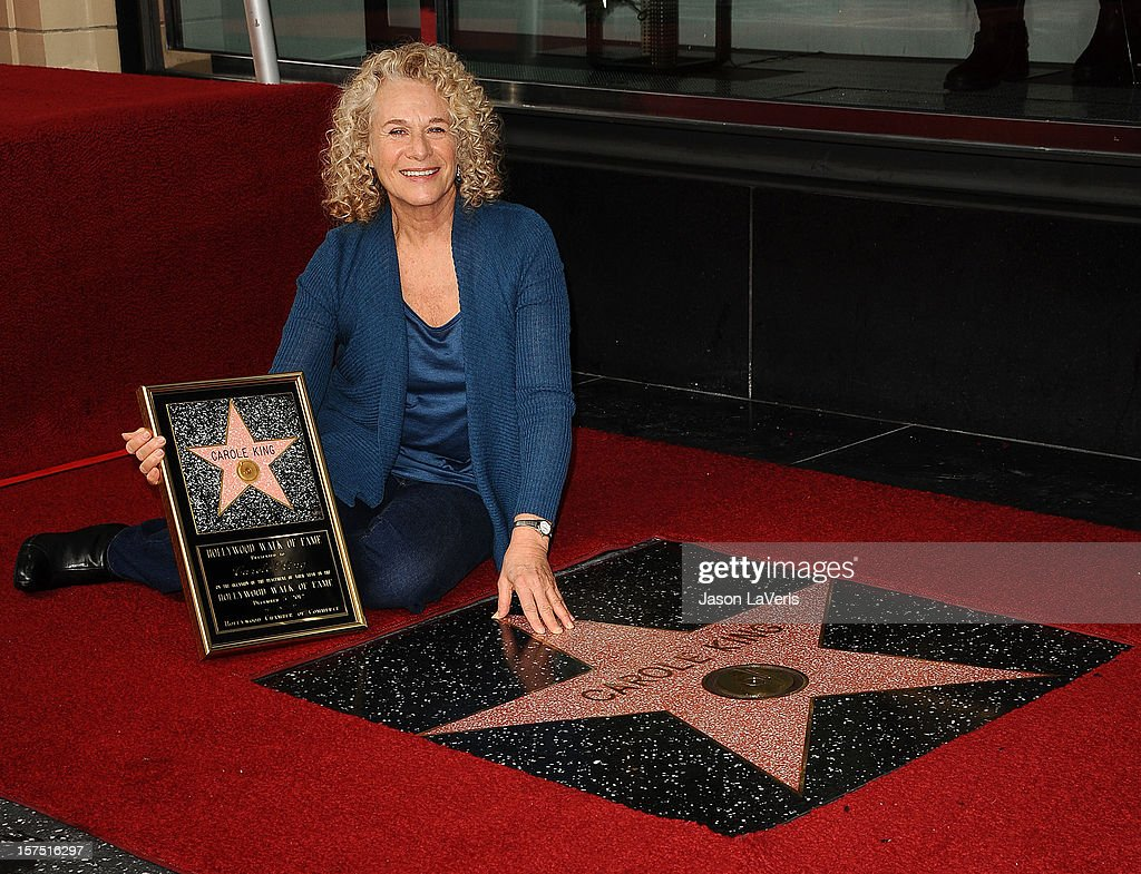 Carole King is honored with a star on the Hollywood Walk of Fame on December 3, 2012 in Hollywood, California.