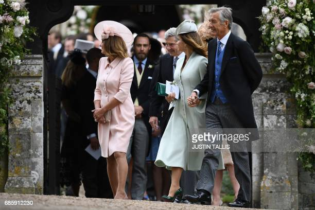 Carole Middleton and her husband Michael Middleton leave St Mark's Church in Englefield west of London on May 20 after attending the wedding of their...