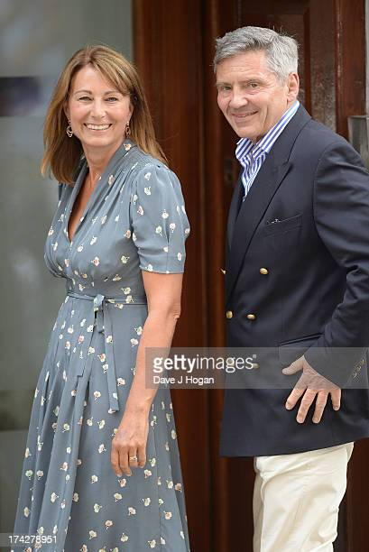 Carole Middleton and Michael Middleton arrive at The Lindo Wing to visit The Duchess Of Cambridge and her newborn son at St Mary's Hospital on July...