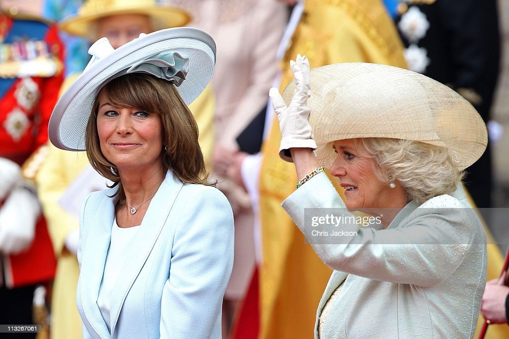 <a gi-track='captionPersonalityLinkClicked' href=/galleries/search?phrase=Carole+Middleton&family=editorial&specificpeople=4079988 ng-click='$event.stopPropagation()'>Carole Middleton</a> smiles as <a gi-track='captionPersonalityLinkClicked' href=/galleries/search?phrase=Camilla+-+Duchess+of+Cornwall&family=editorial&specificpeople=158157 ng-click='$event.stopPropagation()'>Camilla</a>, Duchess of Cornwall waves to the cheering crowds following the marriage of Prince William, Duke of Cambridge and Catherine, Duchess of Cambridge at Westminster Abbey on April 29, 2011 in London, England. The marriage of the second in line to the British throne was led by the Archbishop of Canterbury and was attended by 1900 guests, including foreign Royal family members and heads of state. Thousands of well-wishers from around the world have also flocked to London to witness the spectacle and pageantry of the Royal Wedding.