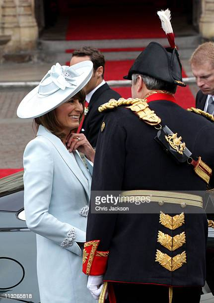 Carole Middleton smiles as she arrives to attend the Royal Wedding of her daughter Catherine Middleton to Prince William of Wales at Westminster...