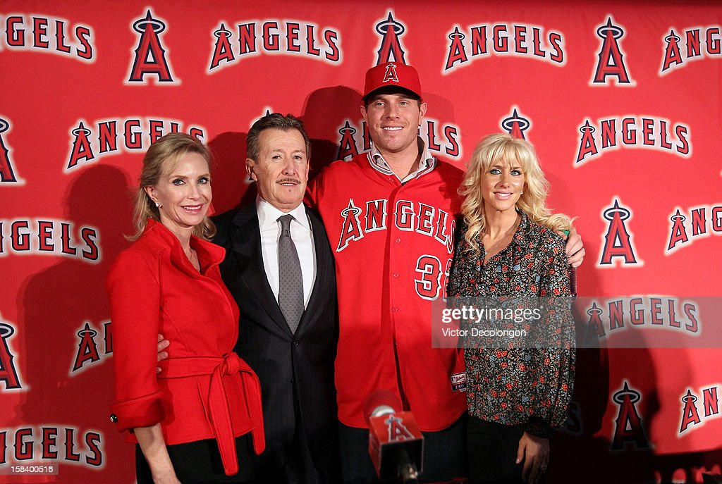 Carole Moreno, Los Angeles Angels of Anaheim Owner Arte Moreno, Josh Hamilton #32 of the Los Angeles Angels of Anaheim and wife Katie Hamilton pose for a group photo during the press conference introducing Hamilton as the team's newest player at ESPN Zone at Downtown Disney on December 15, 2012 in Anaheim, California.