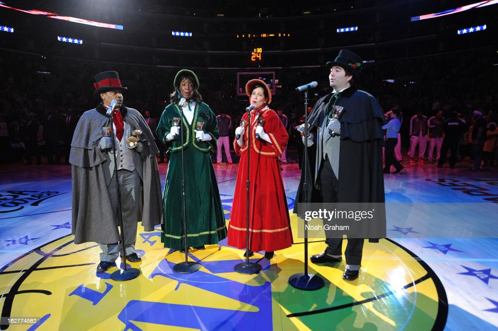 Carolers sing on the court before the game where the New York Knicks took on the Los Angeles Lakers at Staples Center on December 25, 2012 in Los Angeles, California.