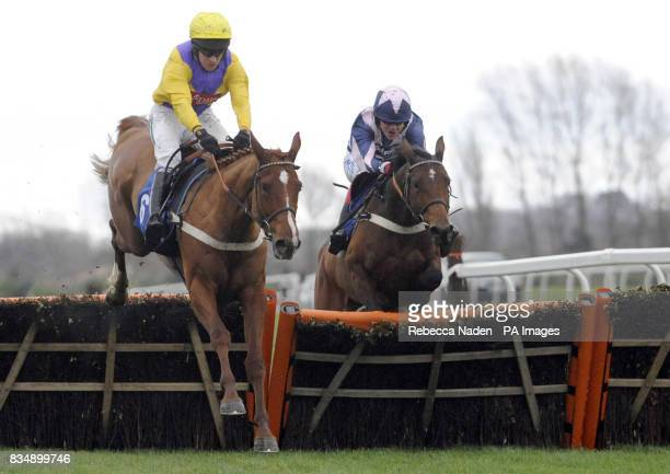 Carole's Legacy ridden by jockey Barry Geraghty jumps the last followed by Over Sixty ridden by jockey Robert Thornton as he goes on to win the EBF/...
