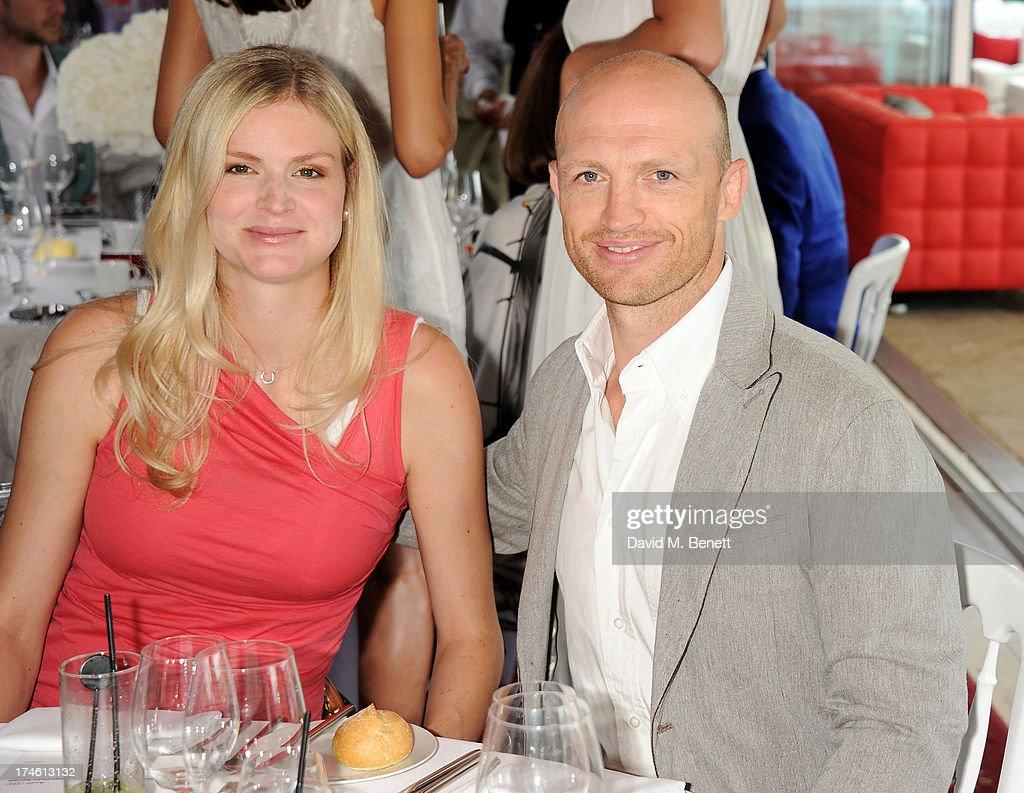 Carolin Hauskeller and Matt Dawson attend the Audi International Polo at Guards Polo Club on July 28 2013 in Egham England