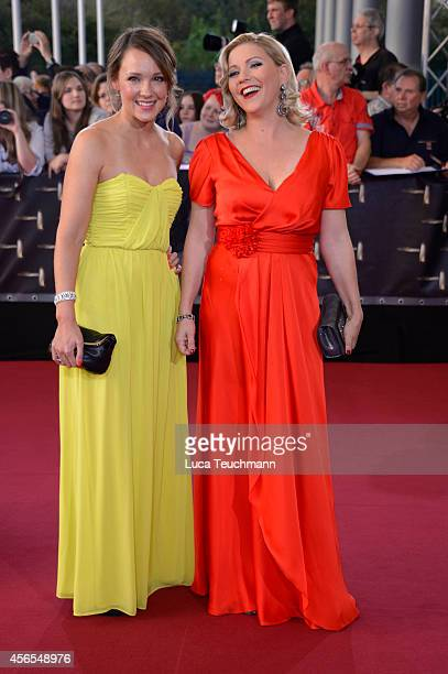 Carolin Kebekus and Alexandra Bechtel attend the red carpet of the Deutscher Fernsehpreis 2014 at Coloneum on October 2 2014 in Cologne Germany