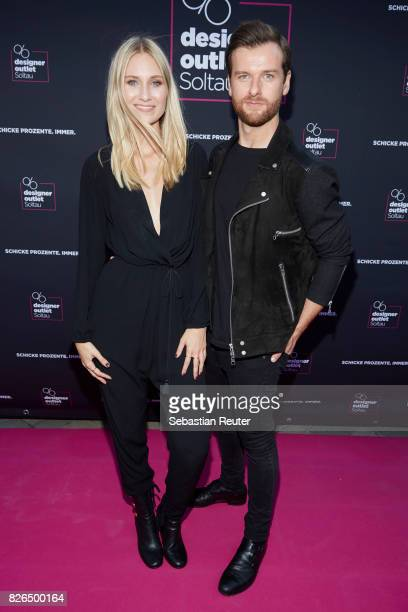 Carolin Niemczyk and Daniel Grunenberg of Glasperlenspiel are seen during the late night shopping at Designer Outlet Soltau on August 4 2017 in...