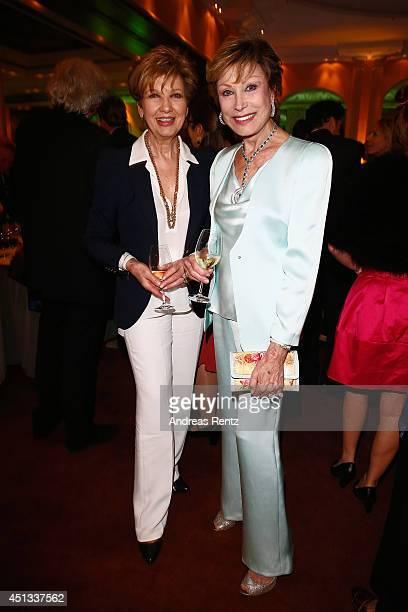 Carolin Reiber and AntjeKatrin Kuehnemann attend the Opening Night of the Munich Film Festival 2014 at Hotel Bayerischer Hof on June 27 2014 in...