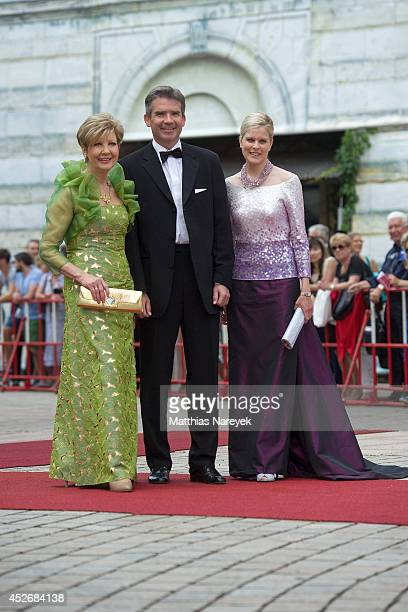 Carolin Reiber Marcus Maier and guest attend the Bayreuth Festival Opening 2014 on July 25 2014 in Bayreuth Germany
